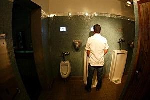 women using mens urinal trough