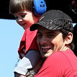 Brad Paisley looks on with his son