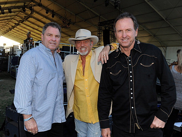 Steve Gatlin, Larry Gatlin, and Rudy Gatlin of the Gatlin Brothers pose backstage