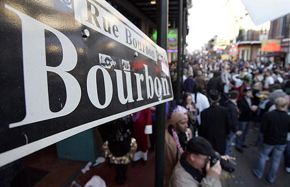 NEW ORLEANS - Revelers walk along Bourbon Street in the French Quarter