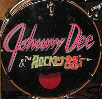 Johnny Dee logo on a drum