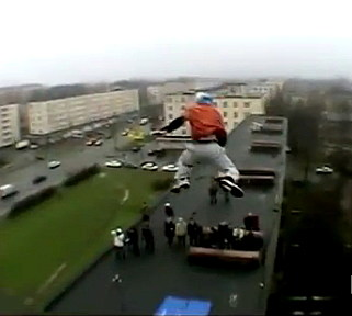 Man Jumping off a Building
