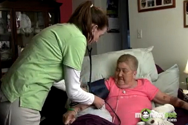Hospice Care Nurse checking blood pressure