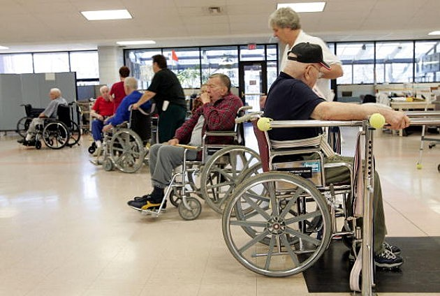 Veterans work out during a physical therapy session at the Quincy Veterans Home