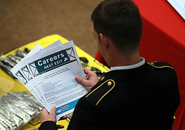 A recruiter with the U.S. Army National Guard looks over a job notice