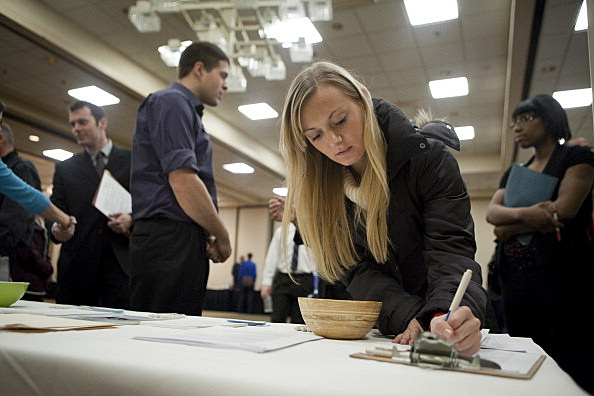 Intern fills out form at a job fair December 2011 Portland, Oregon.