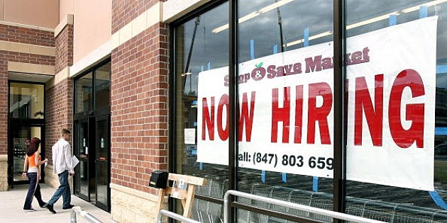 Now Hiring sign into a new grocery store under construction