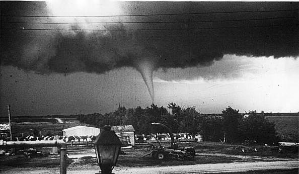 May 26th 1959: The destructive funnel cloud of a tornado touches ground.