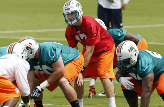 Ryan Tannehill taking a snap at Dolphins Training Camp