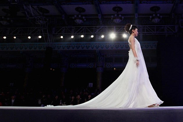 Model showcases designers Long Train Wedding Dress