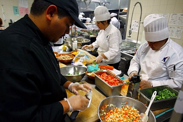 Student chefs prepare their food during the Cooking Up Change
