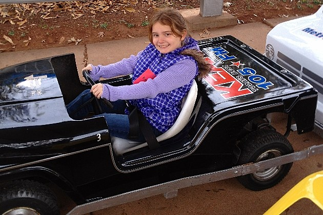 Angie riding a Safety city car