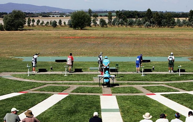 Men shooting in the Men's Trap event