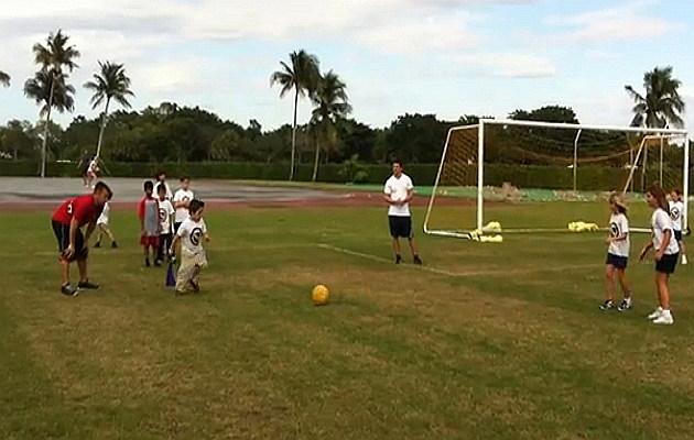 Florida kids playing kick ball