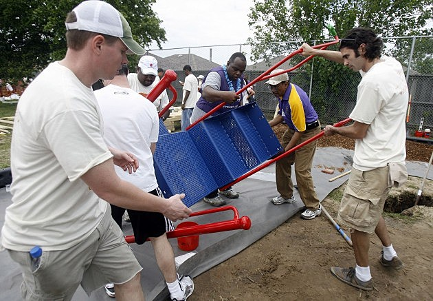 Volunteers work together to build playground in New Orleans