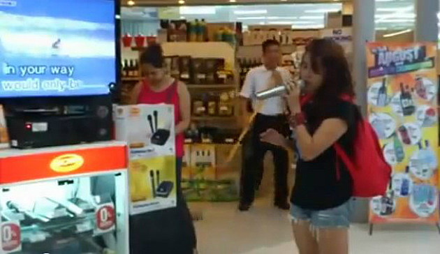 'Random Girl' sings karaoke at the mall