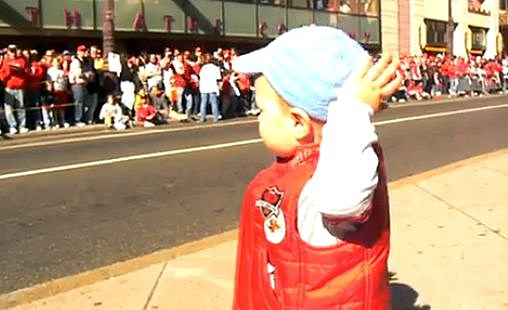 boy leading cheering crowd