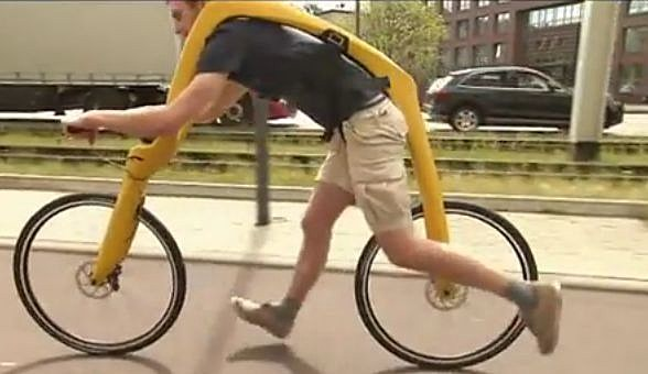 man on pedal-less bike