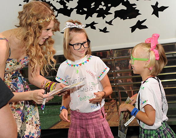 Taylor Swift and some tiny fans