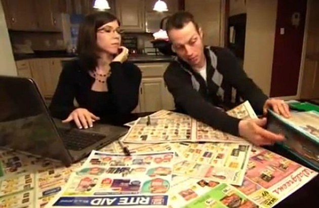 Extreme couponing couple planning their shopping trip