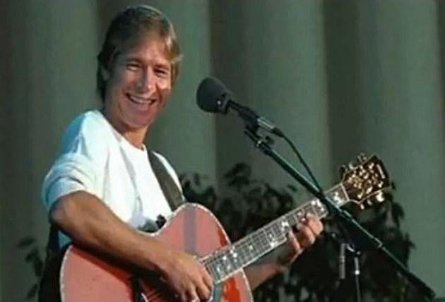 John Denver with his guitar