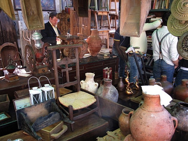 A booth selling antiques at the market.