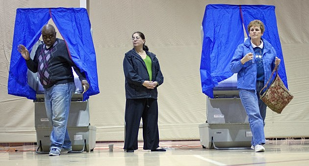 Voters place their votes in the election