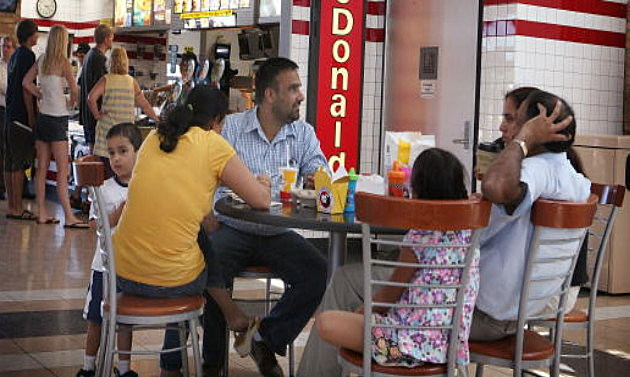 A family eats at a fast-food restaurant