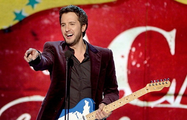 Luke Bryan accepts the Artist of the Year award onstage