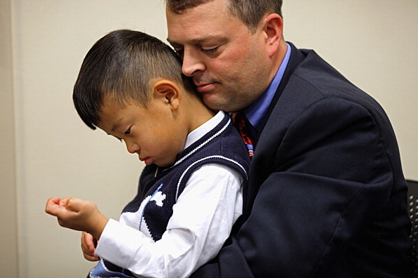 Adoptive parent with child
