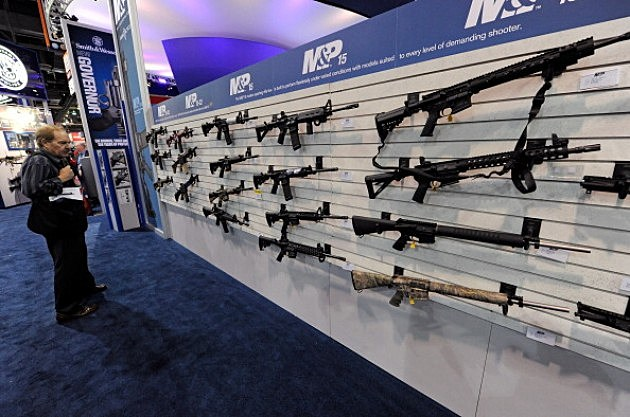 An attendee looks at Smith & Wesson M&P15's