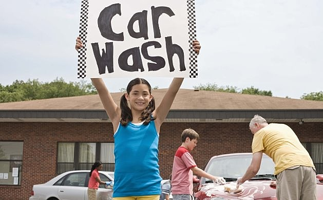 Kid With Car Wash Sign