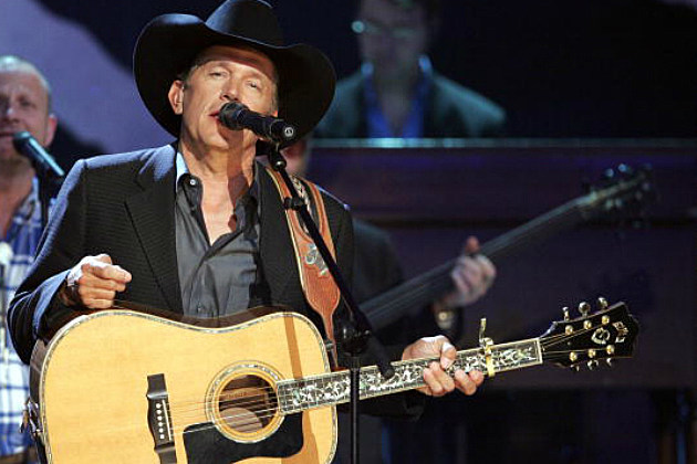 George Strait performs on stage
