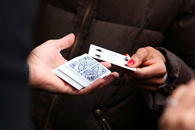 Magician performs magic card trick