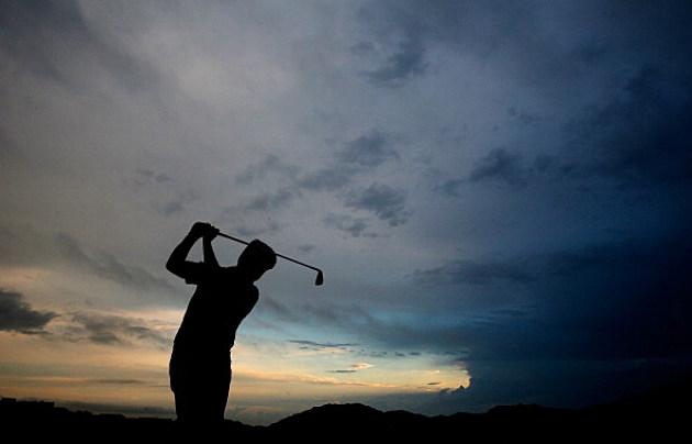 Golfer swing silhouette