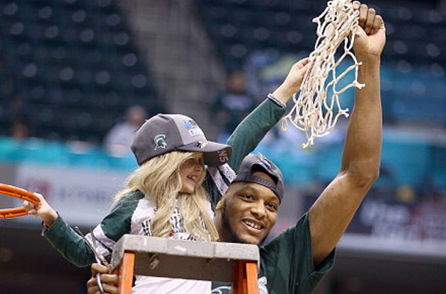 Adreian Payne and Lacey Holsworth cut down the net a the 2014 Big Ten Basketball Tournament