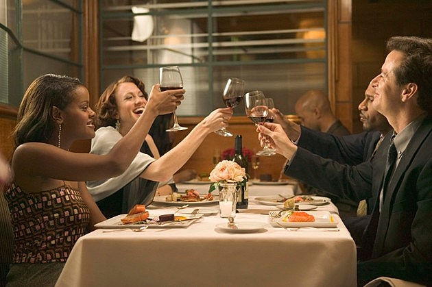 Couples toasting wine at restaurant